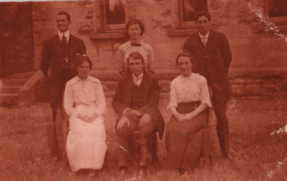 Unknown group with Doris Turpin, front left seated in all white outfit