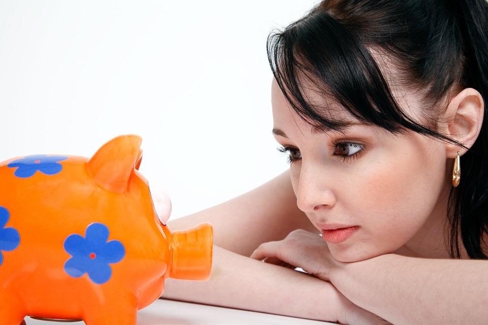 woman looking at pig